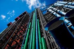 Colored pipes on Centre Goerge Pompidou in Paris under blue sky with small clouds