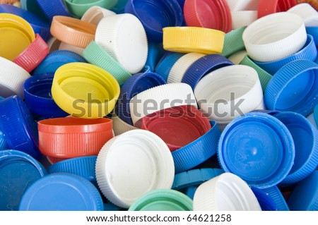 Colored plastic bottle tops to recycle.