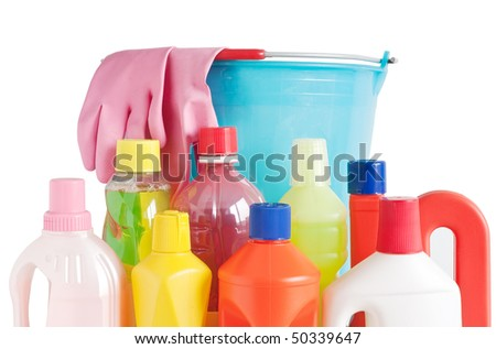 Colored plastic detergent bottles with bucket and gloves isolated on white background with clipping path