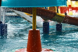 Colored plastic water slides with pool in outdoor aqua park