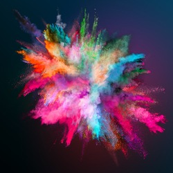 Colored powder explosion on dark gradient background. Freeze motion.