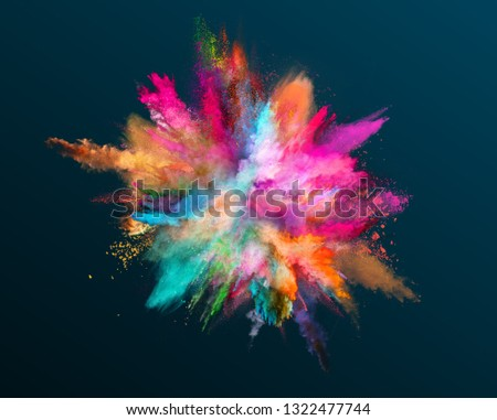 Colored powder explosion on dark gradient background. Freeze motion. #1322477744
