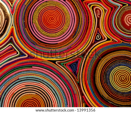 Colored rings of felt on a carpet - stock photo