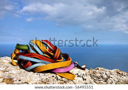 Colored ropes on the rock against the blue sky