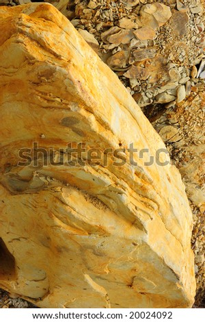 colored rough yellow surface of rock