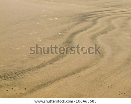 Colored Sand Patterns Created by Waves and Wind