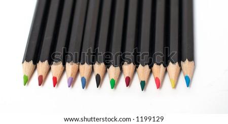 Colored school pencils stacked. Macro