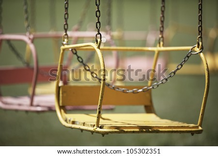 Colored seats of a carousel - selective focus