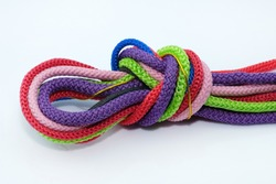 Colored shoe laces with polyester on a white background. round Polyester cord tied in a knot, serhu look. Drawstrings for adjusting hoods and belts in sportswear.