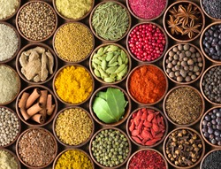 Colored spice background. Spices and herbs top view