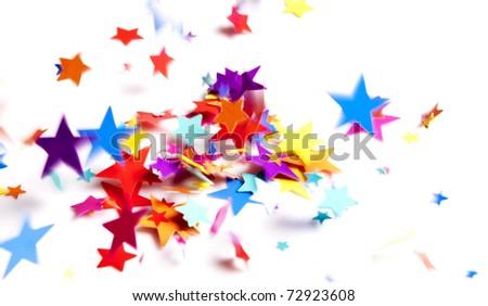 colored stars confetti falling on white