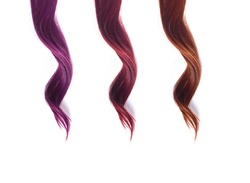 colored strands of hair curls on a white background