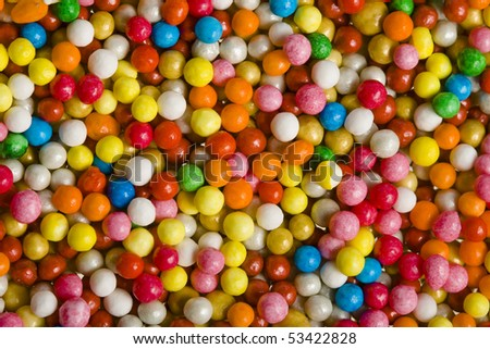 colored sweet candies spreading surface top view  background