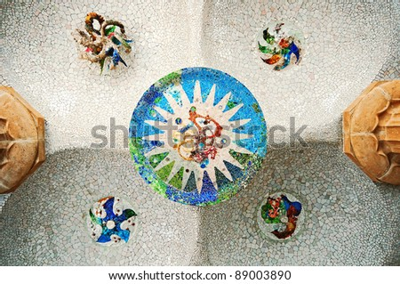 Colored tile mosaic on the ceiling of the Hypostyle Hall in Parc Guell in Barcelona.