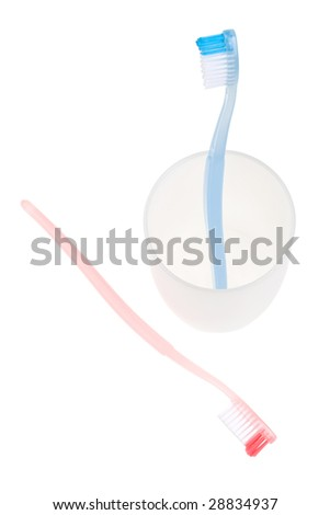 Colored toothbrush in glass. With clipping path.