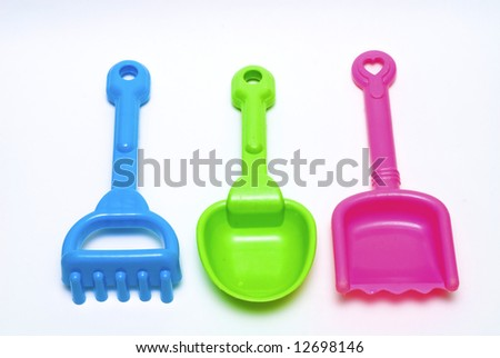 Colored toys for the game in the sand on the beach - stock photo