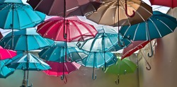 Colored umbrellas fly free