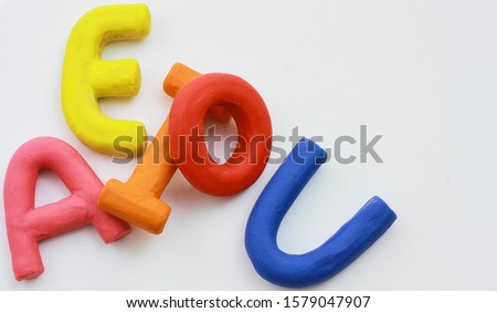 colored vowels in clay with white background Stok fotoğraf ©