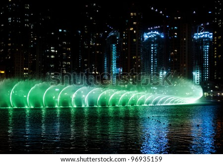 Colored water fountain at night . Dubai UAE