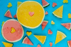 Colored watermelons in pieces with heart figures.