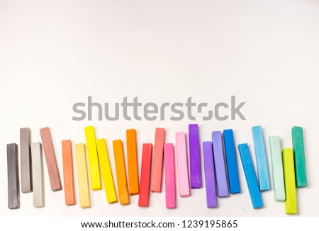 Colored wax crayons (oil pastel) on a white background. Colorful chalk. Education, arts,creative, back to school. Pastels #1239195865