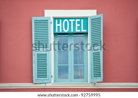 Colored Window with Hotel neon sign - stock photo