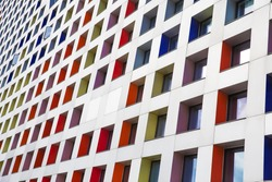 colored windows of the building. geometric background. building's facade