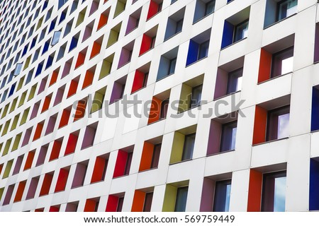 colored windows of the building. geometric background. building's facade #569759449