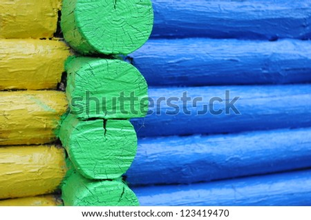 Colored wooden logs, background - stock photo