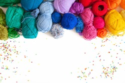 Colored yarn on a white background. Skeins of wool yarn for knitting. Colored confetti.