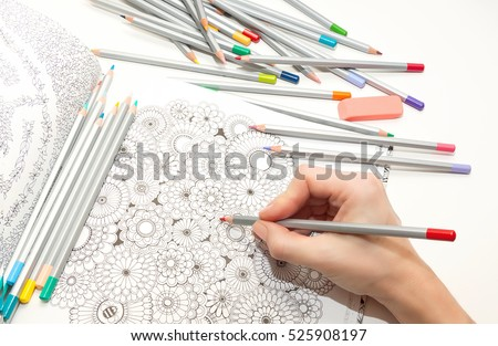 colorer - antistress with colored pencils.The woman draws thereby relieves stress #525908197