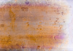 Colorful abstract background. Rusty aged texture. Yellow purple distressed surface with grainy splotches dirt dust scratches. Dry acrylic paint drip creative design.