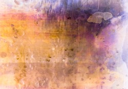 Colorful abstract background. Rusty pattern. Orange purple weathered stained surface with drip splotches dirt dust scratches. Dry ink drip grunge effect.