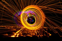 Colorful abstract created by night painting with moving lights and spinning  fire.