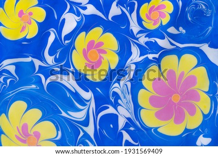 colorful abstract flowers on blue background with waves. Traditional Turkish Ebru art. liquid texture Stok fotoğraf ©