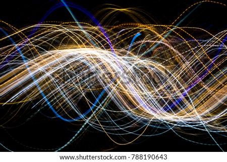 Colorful abstract light trail on black background. #788190643