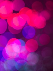 colorful abstract wallpaper with round shaped pink magenta and blue defocused lights