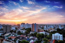 Colorful aerial view of Barranquilla, Colombia towards the river at sunset