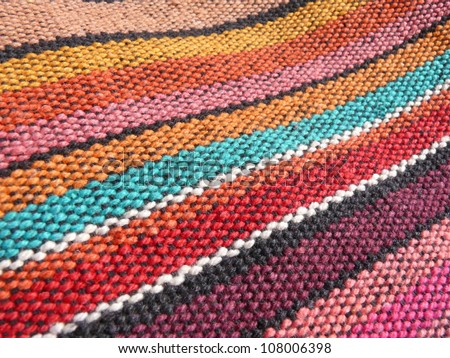 Colorful african peruvian style rug surface close up.