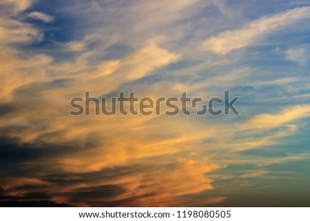 Colorful afterglow sky background with clouds, sky in afterglow(sunset, orange couds)