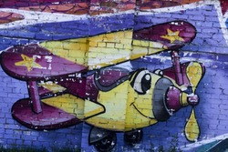 Colorful airplane on the wall