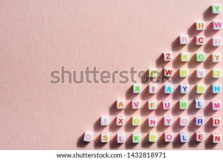 Colorful alphabetical cubes on pink bright background  #1432818971