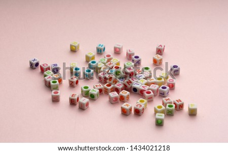 Colorful alphabetical letters cubes on pink background #1434021218