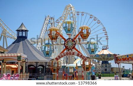 Colorful amusement park rides - stock photo