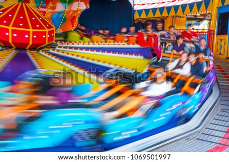 colorful amusement ride in motion
