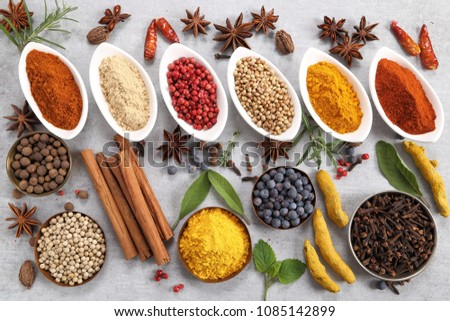 Colorful and aromatic spices and herbs. Food additives. #1085142899