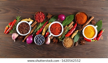 Colorful and aromatic spices and herbs. Food additives. Top view.