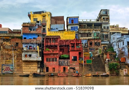 Colorful and chaotic houses on the banks of river Ganges, Varanasi, India