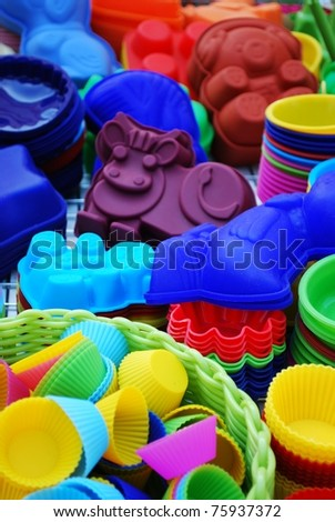 Colorful and differently shaped silicone baking pans on sale at market