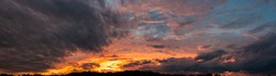 Colorful and dramatic sky panorama of sunset background. vivid and contrast storm clouds